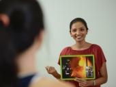 Teacher demonstrating how to speak using visuals